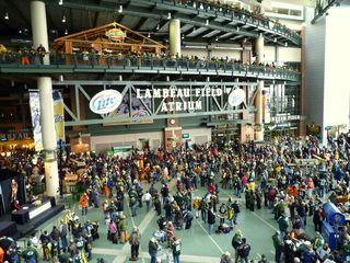 the atrium at lambeau field is a large area that features a number of concession stands on the main floor the packers pre game radio show was going on in