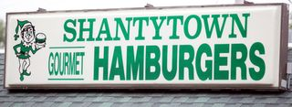 Shantytown sign heavy table jason walker