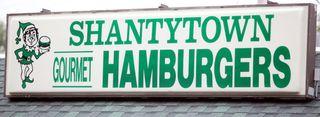 Shantytown sign heavy table jason walker